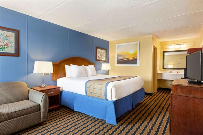 Days Inn & Suites by WyndhamFort Bragg/Cross Creek Mall - Fayetteville - Schlafzimmer
