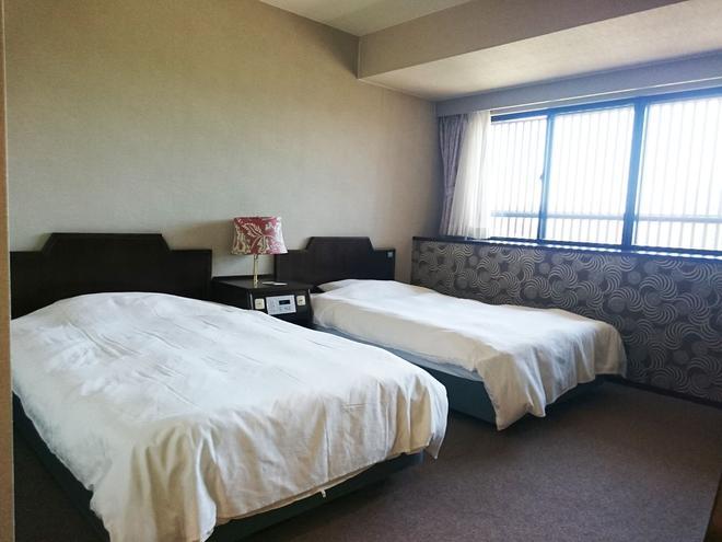 Centrale Hotel Kyotango - Kyotango - Schlafzimmer