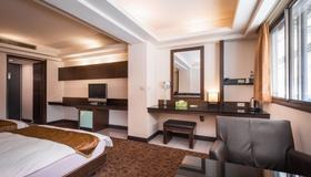 The Enterpriser Hotel - Đài Trung - Phòng ngủ