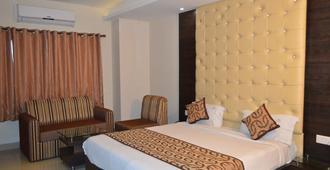 Hotel Galaxy - Prayagraj - Bedroom