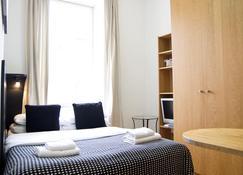 Studios 2 Let Serviced Apartments - Cartwright Gardens - Лондон - Спальня