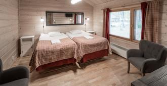 Lapland Hotels Ounasvaara Chalets - Rovaniemi - Schlafzimmer