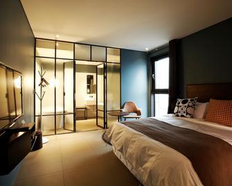 Urban Boutique Hotel - Аньян - Спальня