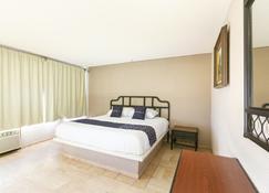 Hotel Iq - El Rosario - Camera da letto