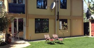 Papagei Home - Moshi - Edificio