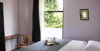 Bed & Chai Guest House - New Delhi - Phòng ngủ