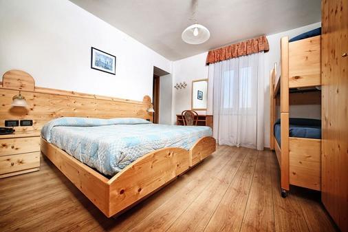 Hotel Stella Alpina - Fai della paganella - Makuuhuone
