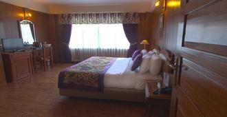Muscatel Himalayan Resort - דאריילינג - חדר שינה