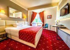Best Western Plus Lido Hotel - Timisoara - Bedroom
