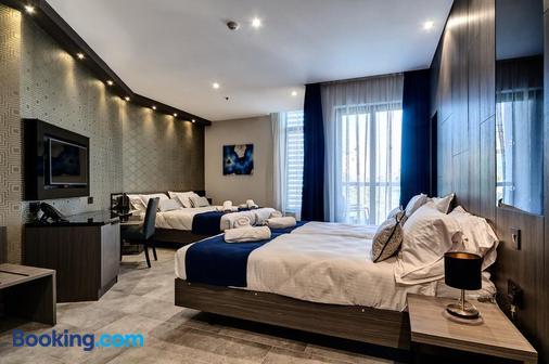 迪斯特瑞克特酒店 - 聖朱利安斯 - 臥室