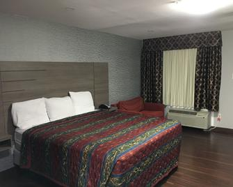 Travel Inn - Humble - Bedroom