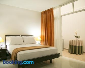 Hotel Casimena - El Yopal - Slaapkamer