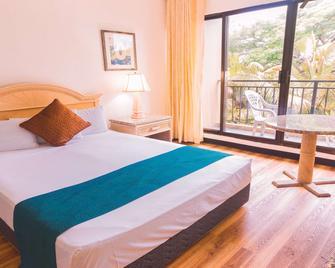 SureStay Hotel by Best Western Guam Airport South - Barrigada - Bedroom