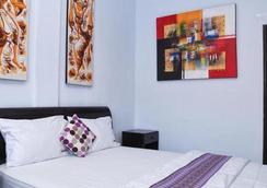 Dekrisna Denpasar - Hostel - Denpasar - Bedroom