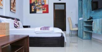 Dekrisna Denpasar - Denpasar - Bedroom