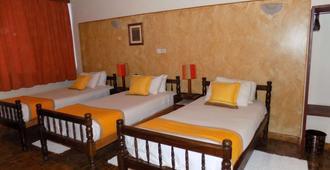 Kenya Comfort Hotel Suites - Nairobi - Bedroom