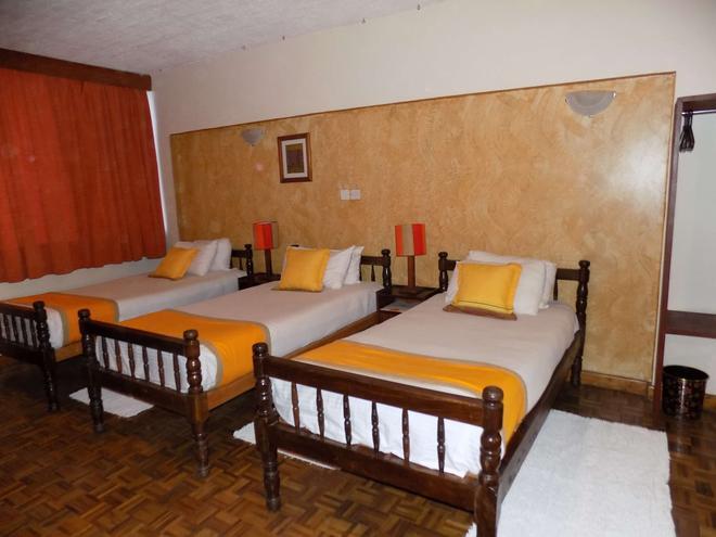 Kenya Comfort Hotel Suites - Nairobi - Habitación