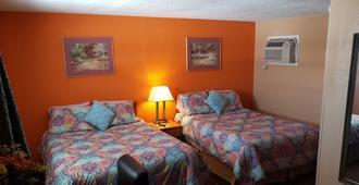 Executive Inn - Cisco - Schlafzimmer