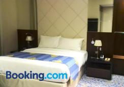 Raviz Center Point Hotel - Dubai - Phòng ngủ