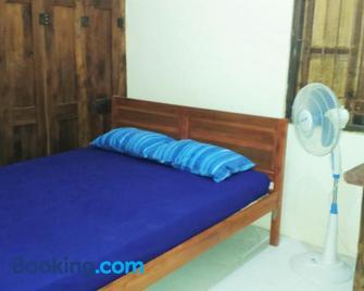 Griya Harja Homestay - Borobudur - Schlafzimmer