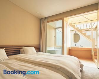 Shonai Hotel Suiden Terrasse - Tsuruoka - Slaapkamer
