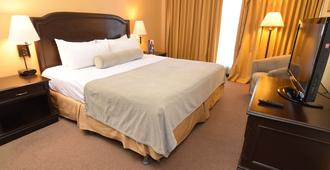 Plaza Hotel and Suites - San Salvador - Schlafzimmer
