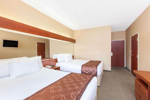 Microtel Inn & Suites by Wyndham Rogers - Rogers - Bedroom