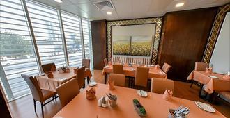 Kingsgate Hotel Doha - Доха - Ресторан