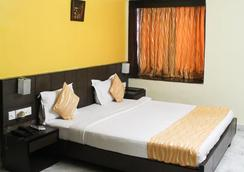Hotel Arya International - Kolkata - Bedroom