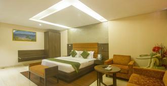 Treebo Trend Rosewood - Mumbai - Phòng ngủ