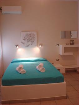 Smaragdi Rooms - Therma - Bedroom