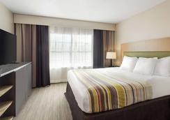 Country Inn & Suites by Radisson Jackson - Airport - Pearl - Κρεβατοκάμαρα