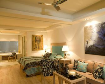 Knossos Beach Bungalows Suites Resort & Spa - Kokkini Hani - Schlafzimmer