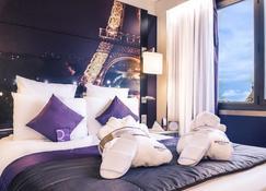 مركيور باريس سنتر تور إيفل - باريس - غرفة نوم