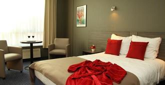 Hotel Binnenhof - Lovaina - Habitación