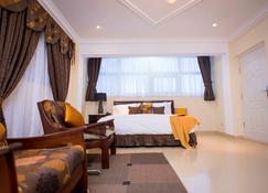 The Ritzz Exclusive Guest House - Acra - Habitación