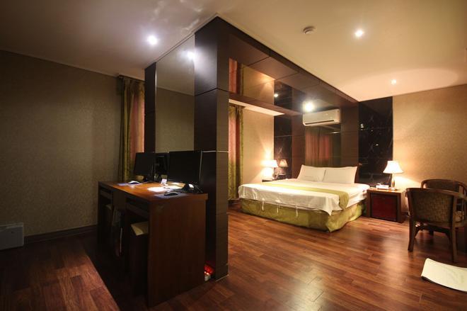 宿諾飯店 - 慶州 - 臥室