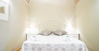 Le Erbe Guest House - ויטרבו - חדר שינה