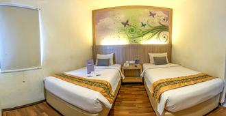 Transera Hotel Pontianak - Pontianak - Habitación