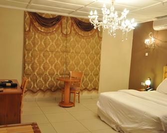 The Country Lodge Hotel - Freetown - Schlafzimmer