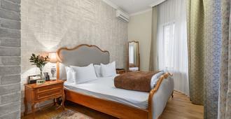 Hotel Vremena Goda - Moscow - Bedroom
