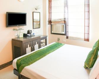 Treebo Trend Swagat Kanpur - Kanpur - Bedroom