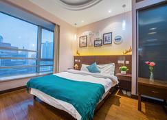 Shanghai Jiarong Hotel Apartment - Shangai - Habitación