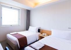 Naha Tokyu Rei Hotel - Naha - Bedroom