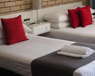Golden Harvest Motor Inn - Moree - Schlafzimmer