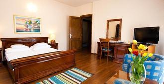 Hotel Onix - קלוז'-נאפוקה - חדר שינה