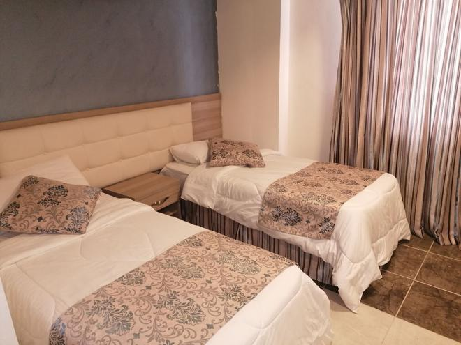 Milano Hotel Suites - Amman - Phòng ngủ