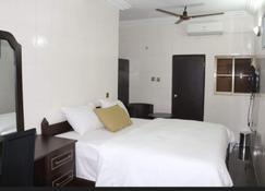 Cute Villa Hotel and Suites - Uyo - Bedroom