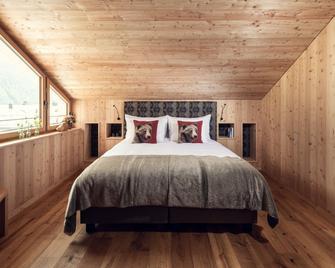 Conrad's Mountain Lodge - Silvaplana - Schlafzimmer