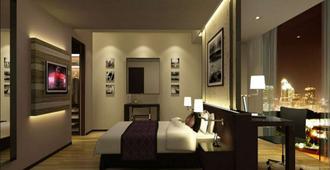 Davanam Sarovar Portico Suites - Bengaluru - Bedroom